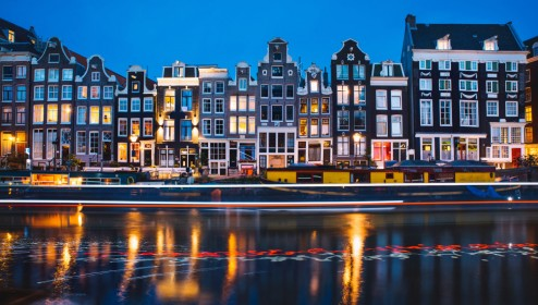 Evening light view over a canal at traditional Amsterdam buildings