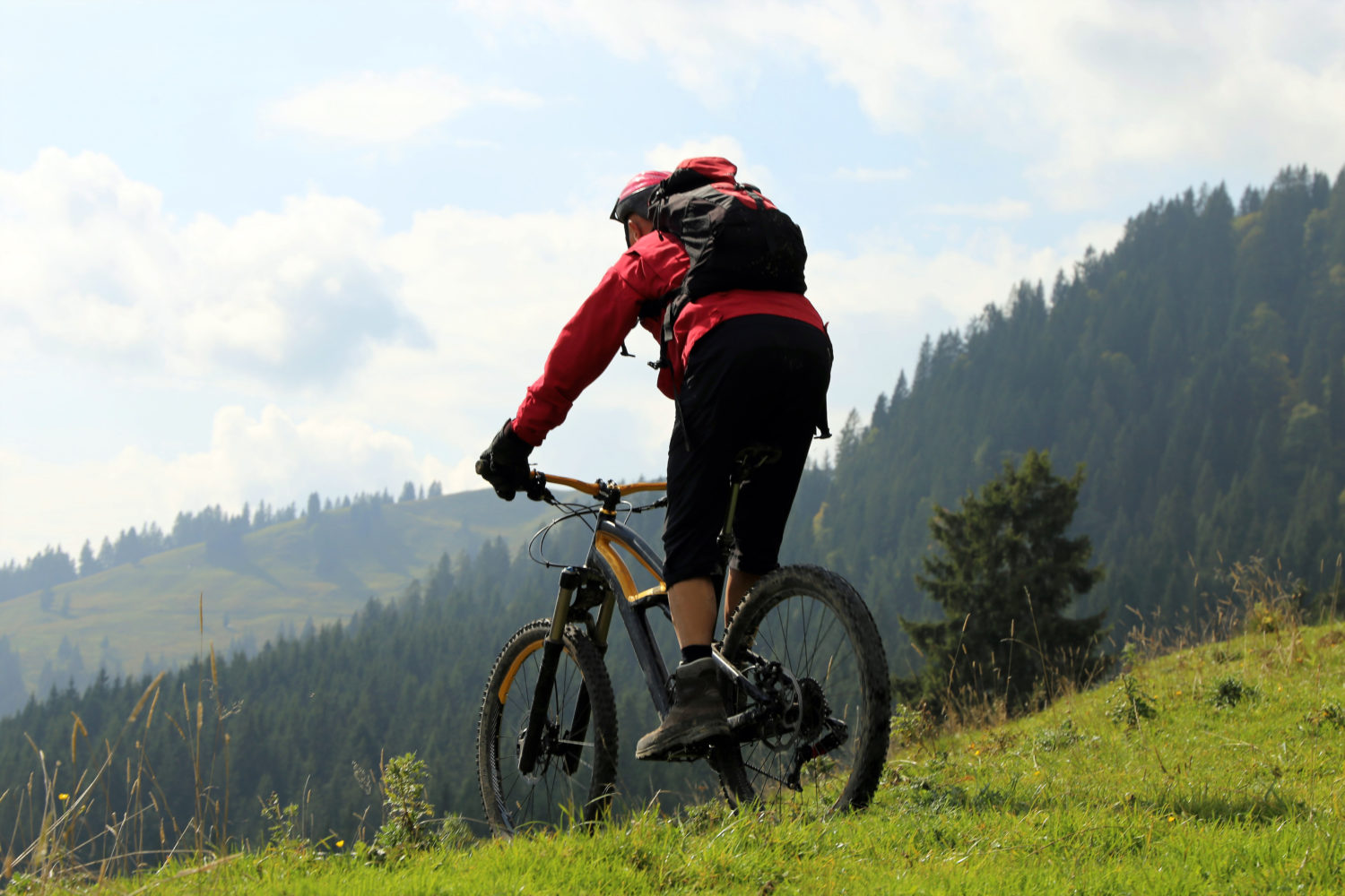 Man on a mountain bike in hilly countryside going from Prague to Munich