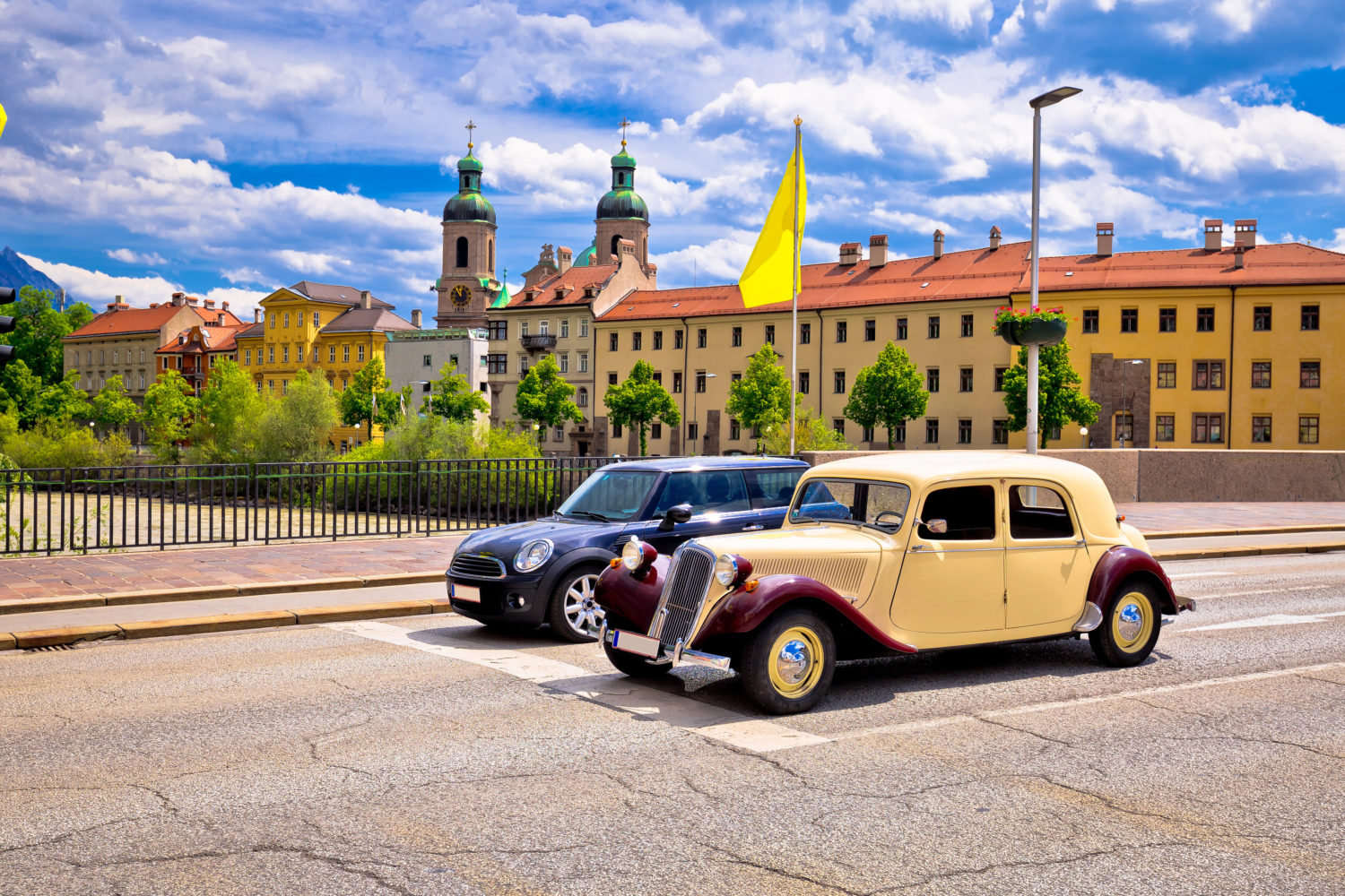 Vintage car for private transfer from Budapest to Vienna on a road in Tirol, Austria