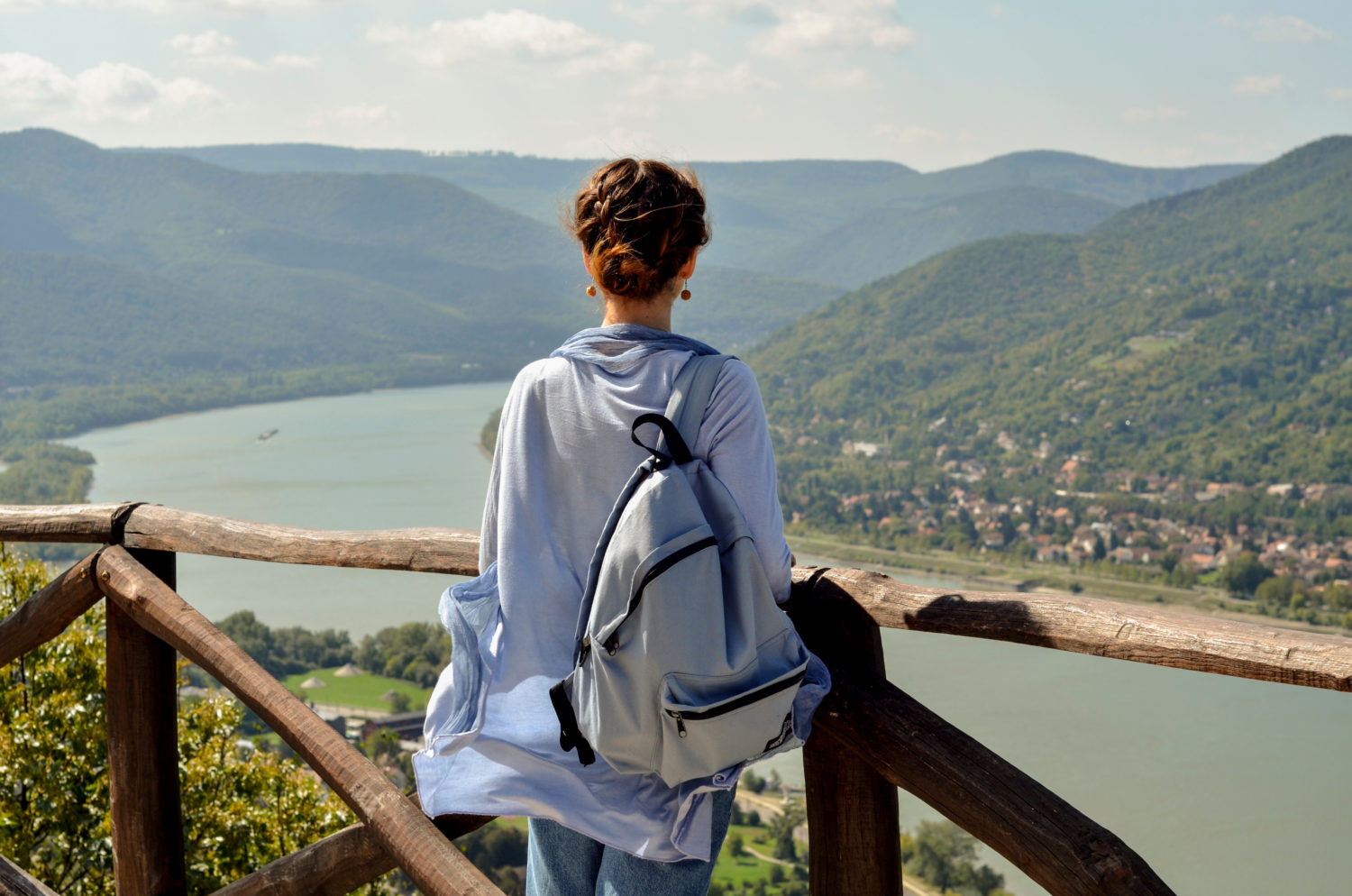 Woman with a backpack overlooking the Danube river