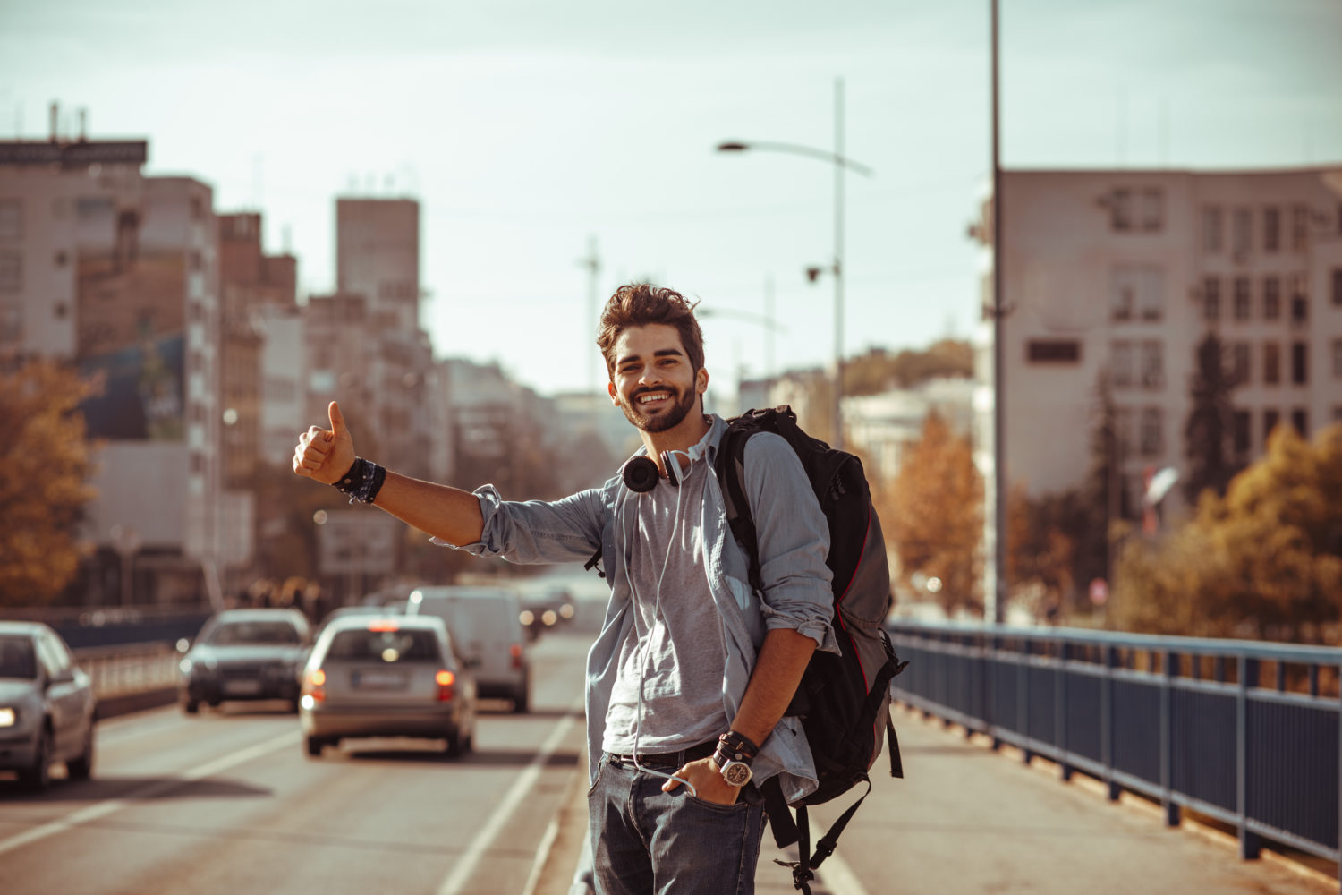 Young man hitchhiking from Prague to Bratislava