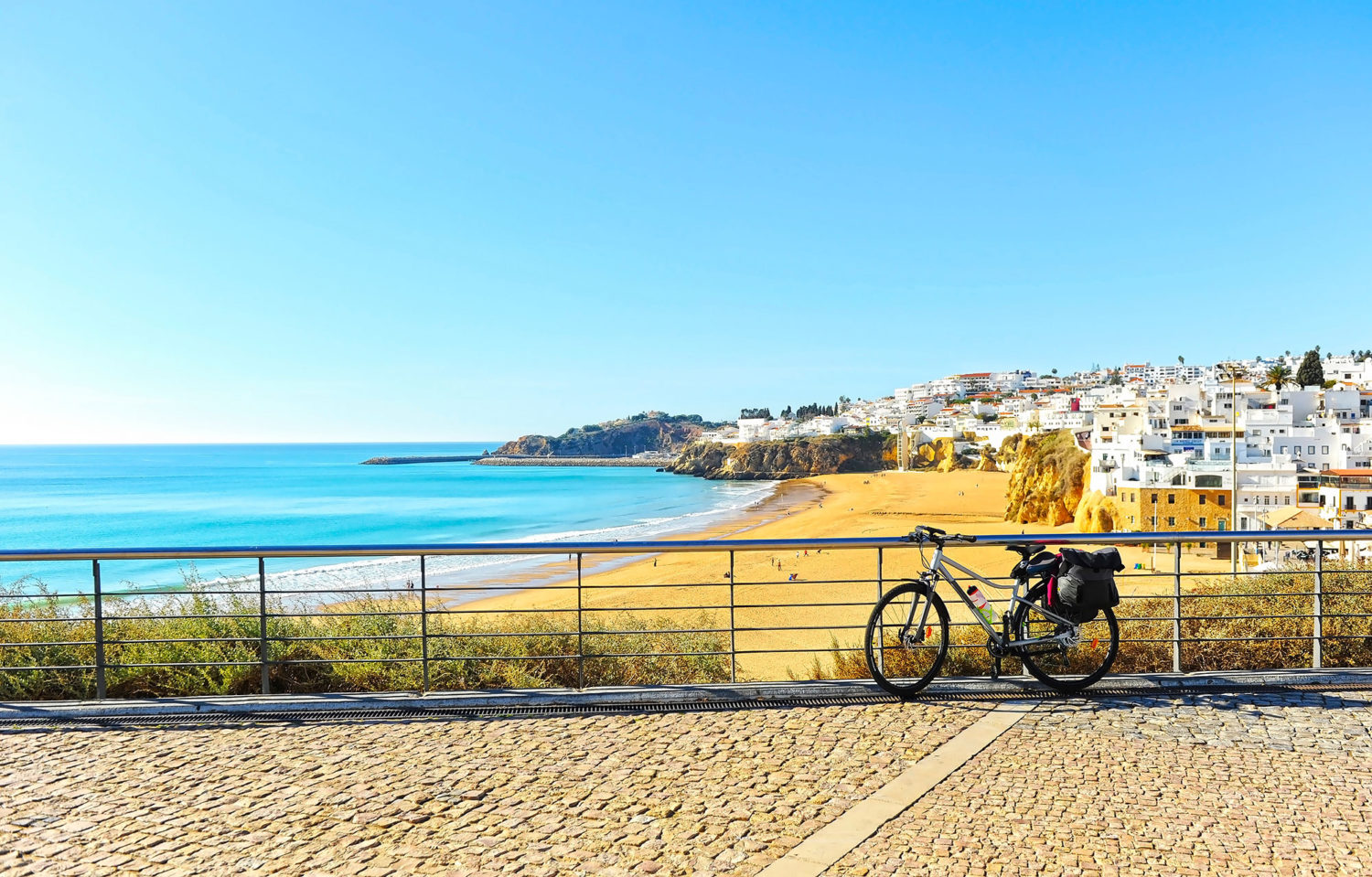 Bicycle near a sandy beach and a seaside town in Portugal